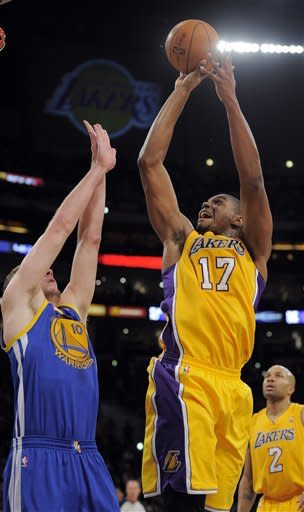 Los Angeles Lakers center Andrew Bynum, center, puts up a shot as Golden State Warriors power forward David Lee, left, defends and point guard Derek Fisher looks on during the first half of their NBA basketball game, Friday, Jan. 6, 2012, in Los Angeles. (AP Photo/Mark J. Terrill)
