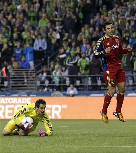 Real Salt Lake's Tony Beltran, right, reacts after Seattle Sounders goalkeeper Michael Gspurning, left, saved Beltran's shot in the second half of an MLS soccer match on Wednesday, Oct. 17, 2012, in Seattle. The teams played to a 0-0 tie. (AP Photo/Ted S. Warren)
