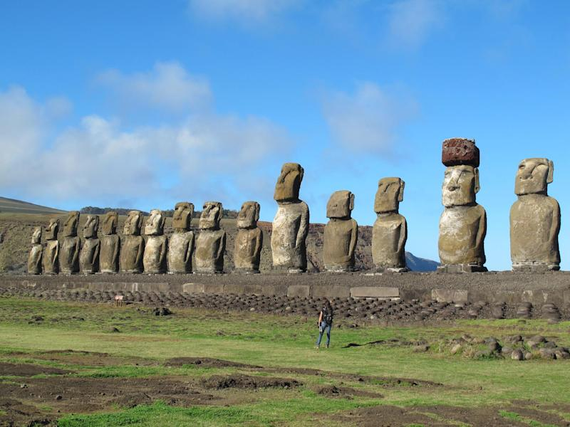 This August 2012 photo shows fifteen moai standing watch at Tongariki on Easter Island. The largest moai on the 720-foot-long platform weighs 97 tons. The site was restored between 1992 and 1996 at a cost of over $2 million, paid for by the Japanese government(AP Photo/Karen Schwartz)