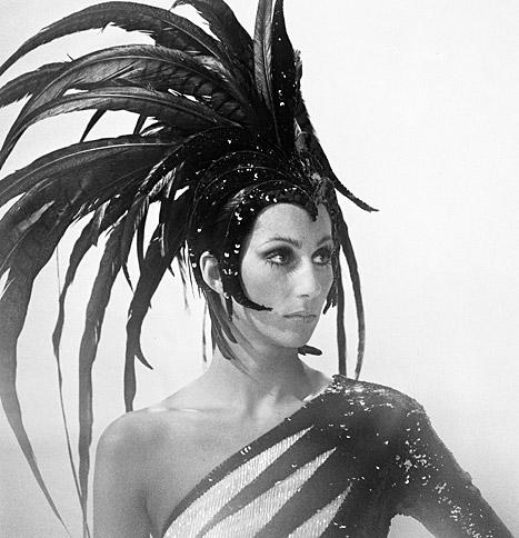 Cher wears a feathered headdress and gown designed by Bob Mackie for The Sonny & Cher Comedy Hour in 1973