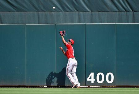FILE PHOTO: Mar 11, 2019; Jupiter, FL, USA; Washington Nationals center fielder Michael Taylor (3) makes a catch at the wall for an out in the third inning of the spring training game against the St. Louis Cardinals at Roger Dean Chevrolet Stadium. Mandatory Credit: Jasen Vinlove-USA TODAY Sports