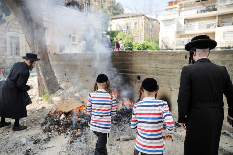 Ultra-Orthodox Jews burn leaven in the Mea Shearim neighbourhood of Jerusalem ahead of the Jewish holiday of Passover