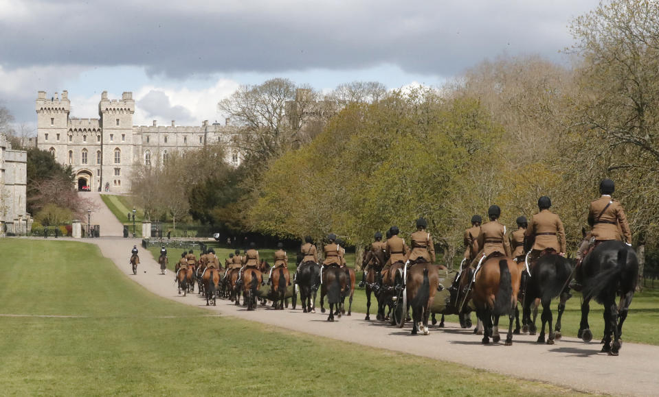 King's Troup Royal Horse Artillery rehearses on the long walk towards Windsor Castle in Windsor, Thursday, April 15, 2021. Britain's Prince Philip, husband of Queen Elizabeth II, died Friday April 9 aged 99. His funeral service will take place on Saturday at Windsor Castle. (AP Photo/Frank Augstein)