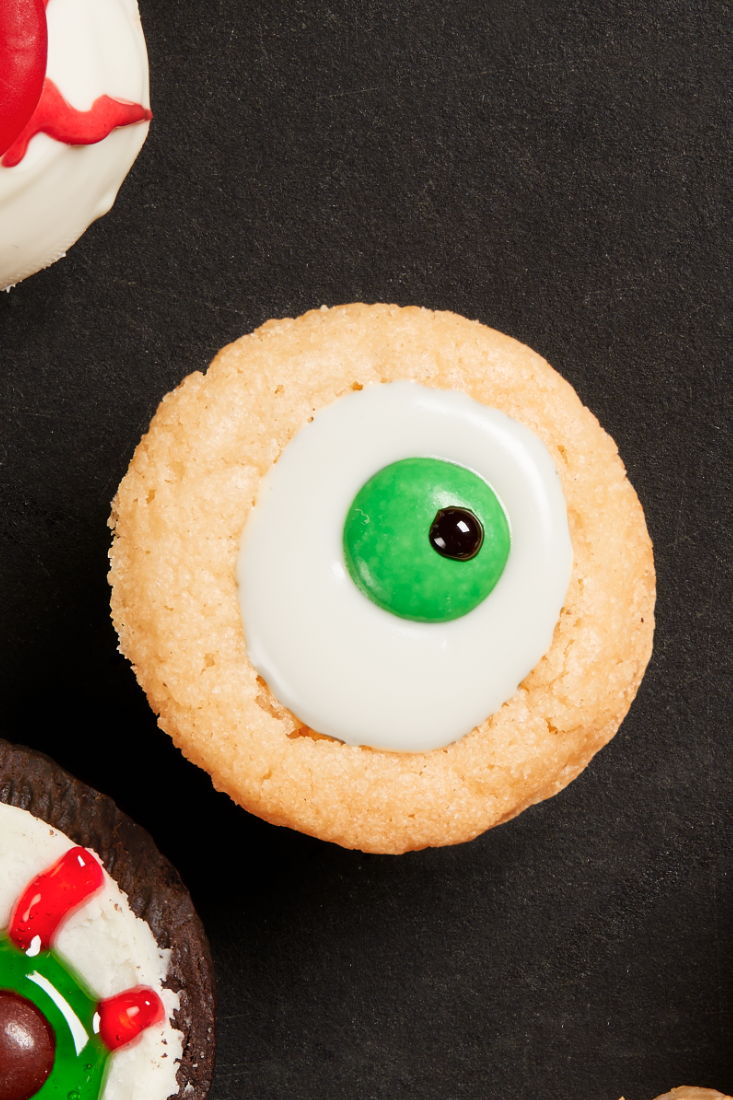 """<p>Sugar cookies are sure to please everyone, and these ones have gotten a spooky Halloween makeover. </p><p><strong><em>Get the recipe at <a href=""""https://www.thepioneerwoman.com/food-cooking/recipes/a32128998/sugar-cookie-eyeballs/"""" rel=""""nofollow noopener"""" target=""""_blank"""" data-ylk=""""slk:The Pioneer Woman"""" class=""""link rapid-noclick-resp"""">The Pioneer Woman</a>. </em></strong></p>"""