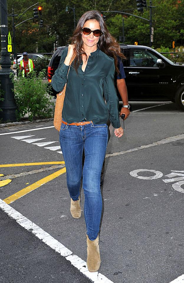 """Is it us or does divorce look pretty good on Katie Holmes? The 33-year-old has been donning plenty of sexy getups since announcing her split from hubby Tom Cruise, and recently showed off another hot one, sporting super-tight skinny jeans, a silk shirt, Oliver Peoples shades, and Isabel Marant suede boots. And this was just to pick up daughter Suri from gymnastics class! (7/20/2012)<br><br><a target=""""_blank"""" href=""""http://omg.yahoo.com/news/heidi-klum-katie-holmes-great-style-120000069.html"""">Heidi Klum: Katie Holmes """"has great style""""</a>"""