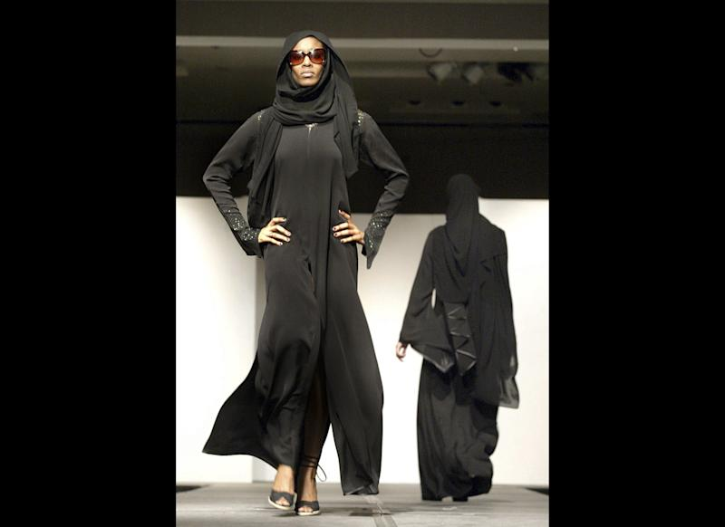An abaya is a long black, loose fitting cloak that often zips or buttons up the front. The sheila is a rectangular scarf that covers the head. Usually made of light silk material and most often found in black, but can be as simple or elaborate as the wearer so chooses. Generally these garments are part of a region's traditional dress, and are therefore worn for cultural reasons rather than religious purposes.