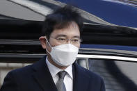 FILE - In this Dec. 30, 2020, file photo, Samsung Electronics Vice Chairman Lee Jae-yong arrives at the Seoul High Court in Seoul, South Korea. Pressure is mounting on South Korean President Moon Jae-in to pardon Samsung heir Lee Jae-yong, who is back in prison after his conviction in a massive corruption scandal, even though business has rarely looked better at South Korea's largest company. (AP Photo/Lee Jin-man, File)