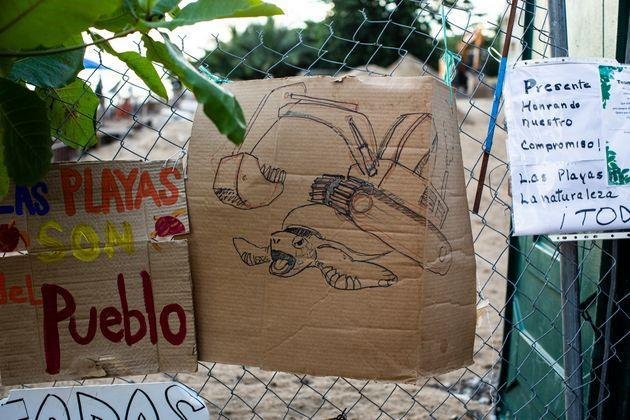 Signs of protest hang on the fence of the residential building. (Photo: Erika P. Rodriguez for HuffPost)
