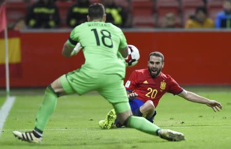 Football Soccer - Spain v Israel - 2018 World Cup Qualifying European Zone - Group G - El Molinon Stadium, Gijon, Spain, 24/3/17 Spain's Dani Carvajal (R) and Israel's goalkeeper Ofir Marciano in action. REUTERS/Eloy Alonso