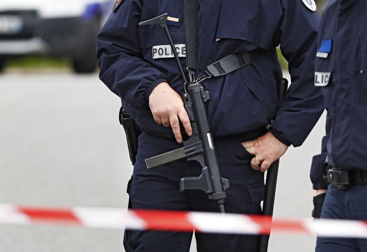 <p>Police man a roadblock at the scene where a French police commander was stabbed to death in front of his home in the Paris suburb of Magnanville, June 14, 2016. (Reuters/Christian Hartmann) </p>