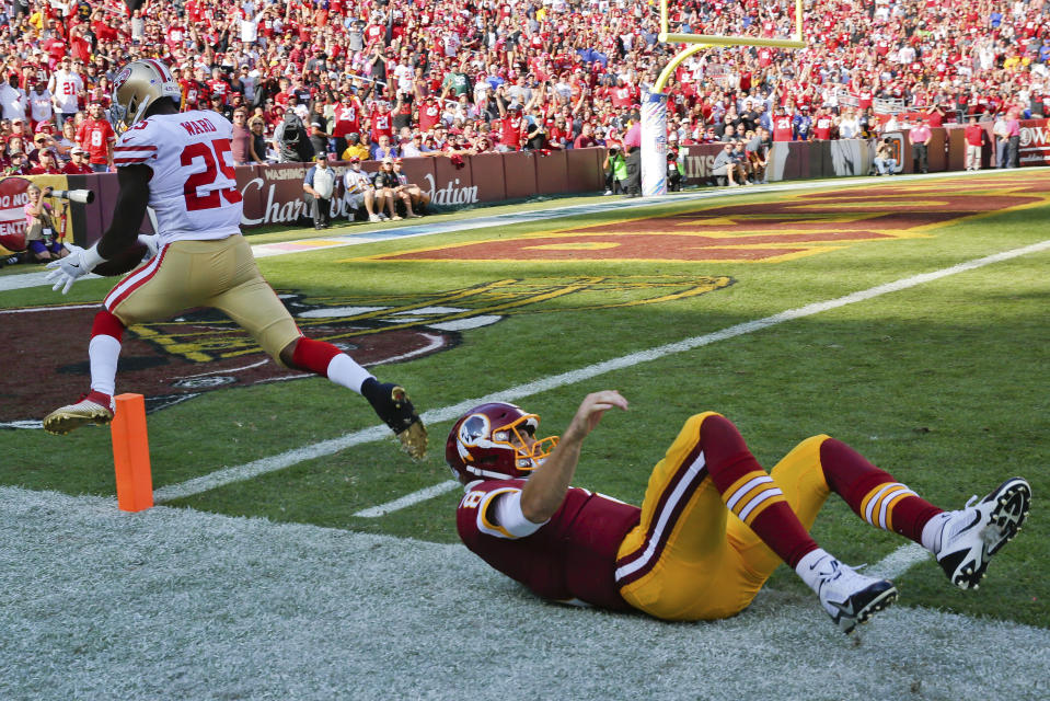 <p>San Francisco 49ers free safety Jimmie Ward (25) is knocked out of bound just shy of the goal line by Washington Redskins quarterback Kirk Cousins (8) after picking up a fumble by Washington Redskins tight end Vernon Davis (85) during the second half of an NFL football game in Landover, Md., Sunday, Oct. 15, 2017. (AP Photo/Pablo Martinez Monsivais) </p>