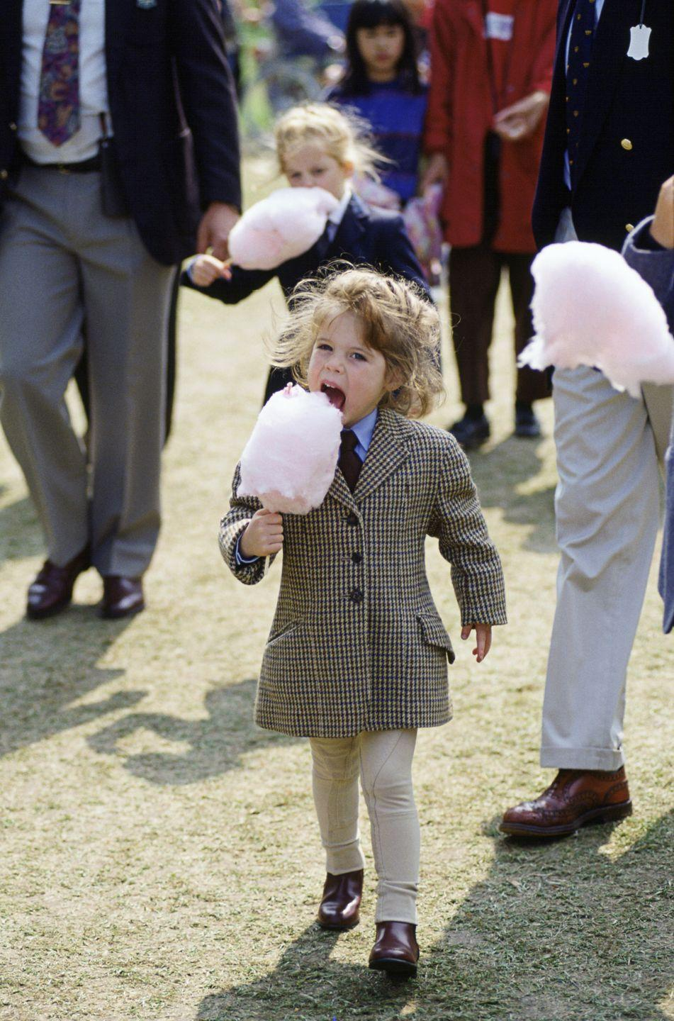 <p>Could Eugenie be any cuter? Here she is eating candyfloss (or cotton candy).</p>