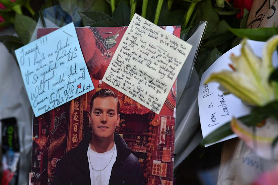 Floral tributes and photographs of the first victim to be named, Jack Merritt: AFP via Getty Images