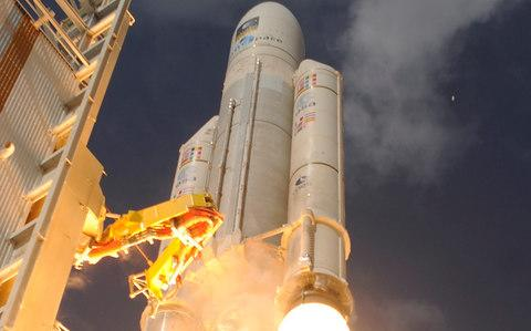 An Ariane 5 rocket containing Galileo staellites blasts off - Credit: STEPHANE CORVAJA