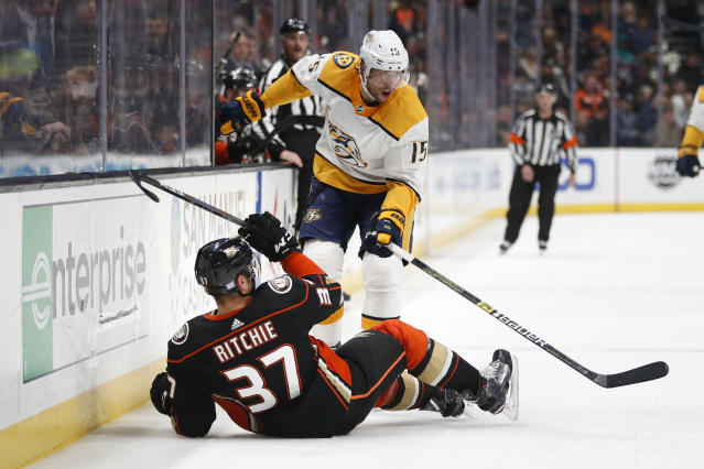 Anaheim Ducks' Nick Ritchie, bottom, falls to the ice after colliding with Nashville Predators' Craig Smith during the first period of an NHL hockey game Monday, Nov. 12, 2018, in Anaheim, Calif. (AP Photo/Jae C. Hong)