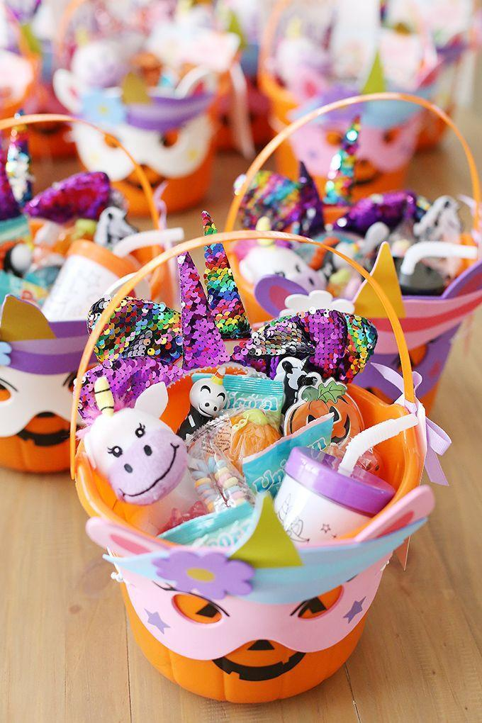 """<p>How cool is it that the pumpkin on this basket is wearing its own unicorn mask? Look inside, and you'll see plenty of other unicorn-themed treats, including <a href=""""https://www.jojobows.com/products/sequin-unicorn-hairband-cute-headbands-for-girls"""" rel=""""nofollow noopener"""" target=""""_blank"""" data-ylk=""""slk:headbands with color-changing sequins"""" class=""""link rapid-noclick-resp"""">headbands with color-changing sequins</a>.</p><p><a href=""""https://seevanessacraft.com/2019/10/youve-been-booed-halloween/"""" rel=""""nofollow noopener"""" target=""""_blank"""" data-ylk=""""slk:See more at See Vanessa Craft »"""" class=""""link rapid-noclick-resp""""><em>See more at See Vanessa Craft »</em></a></p>"""