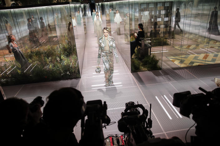 FILE - In this Jan. 27, 2021 file photo, model Cara Delevingne wears a creation for Fendi's Spring-Summer 2021 Haute Couture fashion collection presented in Paris. The pandemic has torn a multibillion-dollar bite out of the fabric of Europe's luxury industry, stopped runway shows and forced brands to show their designs digitally instead. Now, amid hopes of a return to near-normality by the year's end, the industry is asking what fashion will look like as it dusts itself and struggles to its well-heeled feet again. (AP Photo/Francois Mori, File)