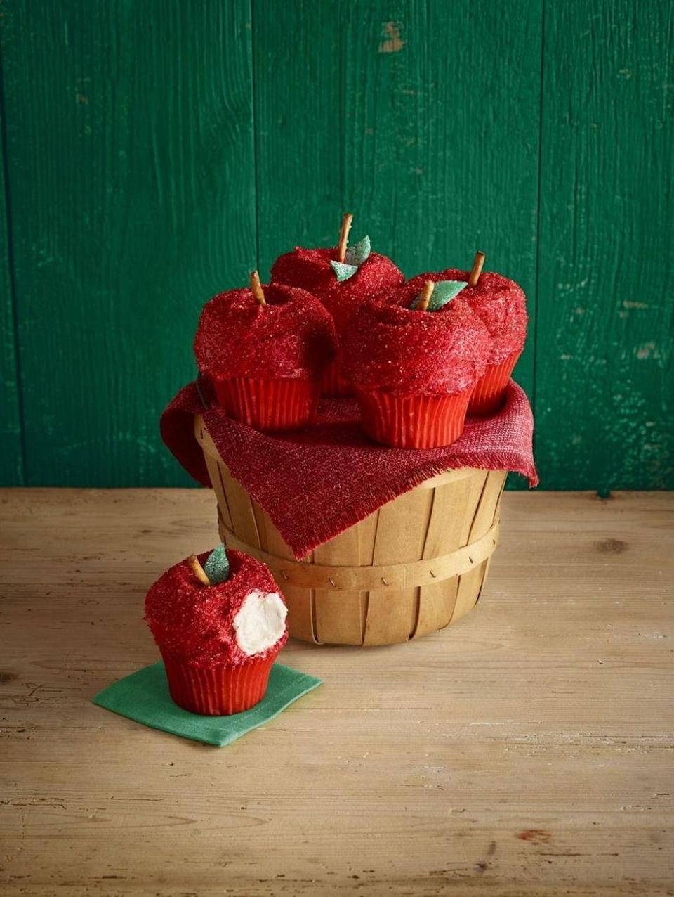 """<p>Here's what happens when cupcakes dress up like apples for Halloween! Top homemade or store-bought cupcakes with mini donuts and cover with frosting for cutest-ever treat.</p><p><em><a href=""""https://www.womansday.com/food-recipes/food-drinks/recipes/a56452/apple-cupcakes-recipe/"""" rel=""""nofollow noopener"""" target=""""_blank"""" data-ylk=""""slk:Get the recipe from Woman's Day »"""" class=""""link rapid-noclick-resp"""">Get the recipe from Woman's Day »</a></em></p><p><strong>RELATED: </strong><a href=""""https://www.goodhousekeeping.com/food-recipes/dessert/g768/apple-dessert-recipes/"""" rel=""""nofollow noopener"""" target=""""_blank"""" data-ylk=""""slk:40 Apple Desserts That Are Delicious to the Core"""" class=""""link rapid-noclick-resp"""">40 Apple Desserts That Are Delicious to the Core</a><br></p>"""
