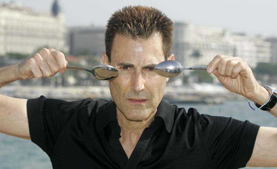 Israeli-British illusionist Uri Geller poses during the 24th MIPCOM (International Film and Program Market for Tv, Video,Cable and Satellite) in Cannes, southeastern France, Tuesday, Oct 14, 2008. (AP Photo/Lionel Cironneau)