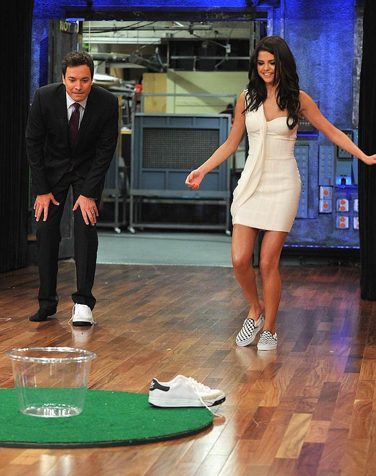 "Though she was there to promote her new album, <i>When the Sun Goes Down</i>, and movie, ""Monte Carlo,"" Selena managed to squeeze in a fun round of ""Shoe Golf."" The game involved her and Jimmy taking off their shoes and trying to get them into buckets. Theo Wargo/<a href=""http://www.gettyimages.com/"" target=""new"">GettyImages.com</a> - June 23, 2011"