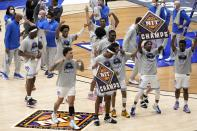 Memphis players and staff celebrate their win against Mississippi State in an NCAA college basketball championship game in the NIT, Sunday, March 28, 2021, in Frisco, Texas. (AP Photo/Tony Gutierrez)