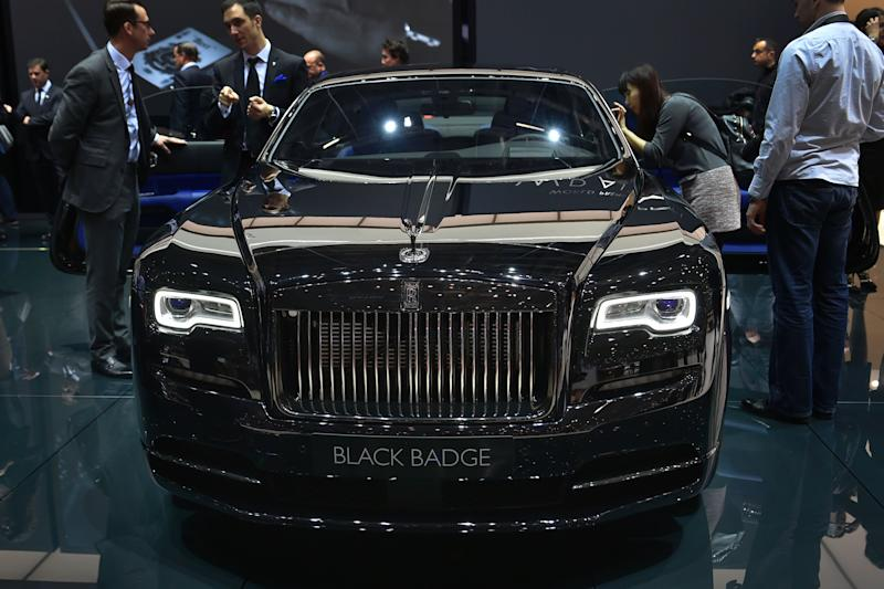 The new Rolls-Royce Wraith Black Badge car model is displayed at the stand of British carmaker during the press day of the Geneva Motor Show on March 2, 2016 in Geneva. / AFP / FABRICE COFFRINI (Photo credit should read FABRICE COFFRINI/AFP via Getty Images)