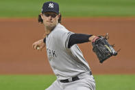 New York Yankees starting pitcher Gerrit Cole (45) in the first inning of Game 1 of an American League wild-card baseball series against the Cleveland Indians, Tuesday, Sept. 29, 2020, in Cleveland. (AP Photo/David Dermer)