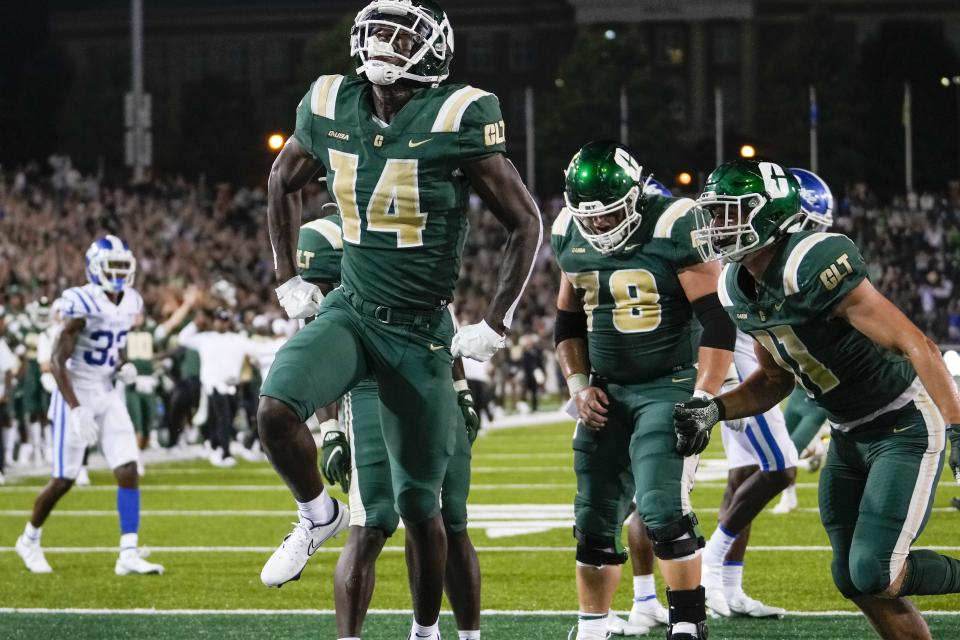 Sep 3, 2021; Charlotte, North Carolina, USA; Charlotte 49ers wide receiver Grant DuBose (14) celebrates after a late touchdown against the Duke Blue Devils during the second half at Jerry Richardson Stadium. Mandatory Credit: Jim Dedmon-USA TODAY Sports