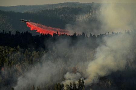 A 747 SuperTanker drops retardant while battling the Ponderosa Fire east of Oroville