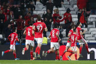 Benfica players celebrate after teammate Pizzi, right, scored their side's second goal during the Champions League group G soccer match between Benfica and Zenit St. Petersburg at the Luz stadium in Lisbon, Tuesday, Dec. 10, 2019. (AP Photo/Armando Franca)