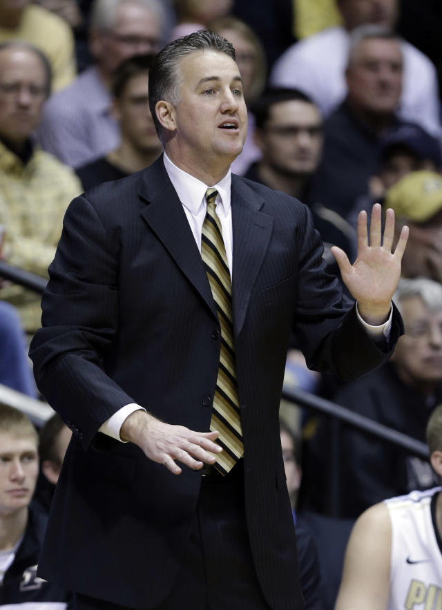 Purdue coach Matt Painter calls to his team during the second half of an NCAA college basketball game against Maryland-Eastern Shore in West Lafayette, Ind., Tuesday, Dec. 17, 2013. Purdue defeated Maryland-Eastern Shore 79-50. (AP Photo/Michael Conroy)