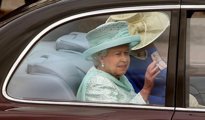 Britain's Queen Elizabeth II leaves Buckingham Palace, London, for a service of thanksgiving at St Paul's Cathedral as the Diamond Jubilee celebrations continue. Tuesday June 5, 2012. (AP Photo/ Lewis Whyld/PA)