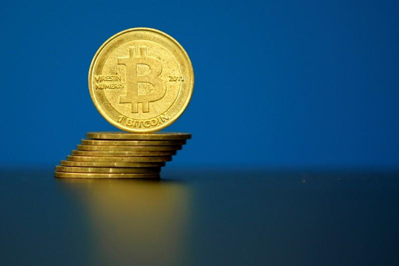 FILE PHOTO: An illustration photo of Bitcoin (virtual currency) coins are seen at La Maison du Bitcoin in Paris