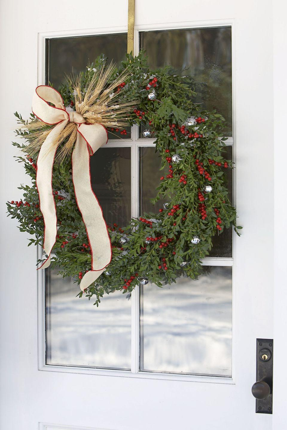 "<p>Steal some <a href=""https://www.goodhousekeeping.com/holidays/christmas-ideas/g469/scandinavian-christmas-decorations/"" rel=""nofollow noopener"" target=""_blank"" data-ylk=""slk:Scandinavian style"" class=""link rapid-noclick-resp"">Scandinavian style</a> for a Nordic Noël. Wheat stalks and winter berries brighten up a plain wreath, and silver bells add a little jingle. </p>"
