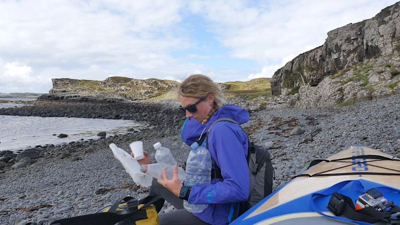 <strong>Cal Major with&nbsp;some of the plastic litter she collected on the Isle of Skye. Look closely and you'll spot more in the distance</strong> (Photo: Cal Major)