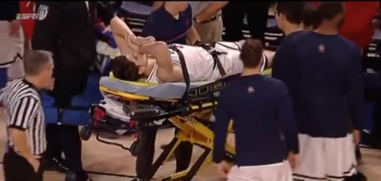 Golden was wheeled off the court on a stretcher, but was alert and responsive. (WatchESPN)