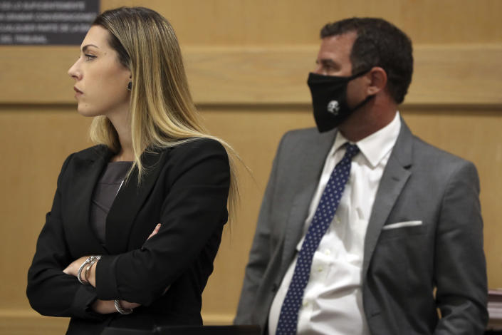 Assistant Public Defender Jaclyn Broudy and defense attorney Gabe Ermine listen during a pre-trial hearing for Parkland school shooter Nikolas Cruz at the Broward County Courthouse in Fort Lauderdale, Fla., Wednesday, July 14, 2021, on four criminal counts stemming from his alleged attack on a Broward jail guard in November 2018. Cruz is accused of punching Sgt. Ray Beltran, wrestling him to the ground and taking his stun gun. (Amy Beth Bennett/South Florida Sun-Sentinel via AP, Pool)