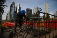 Workers prepares an iron grid for welding at a construction site in the Central Business District (CBD) following an outbreak of the coronavirus disease (COVID-19) in Beijing