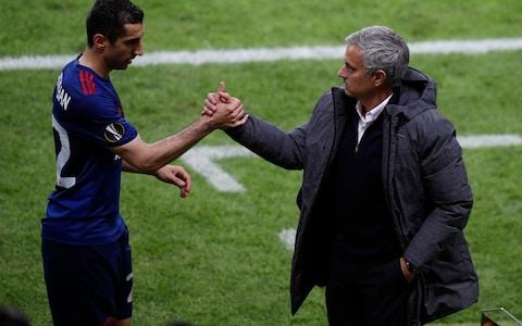 Jose Mourinho (right) with Henrikh Mkhitaryan - Credit: REUTERS