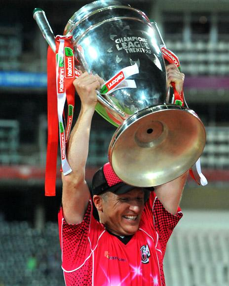 Brad Haddin of the Sixers lifts the trophy after the the Karbonn Smart CLT20 Final match between bizhub Highveld Lions and Sydney Sixers at Bidvest Wanderers Stadiumon October 28, 2012 in Johannesburg, South Africa. (Photo by Duif du Toit/Gallo Images/Getty Images)