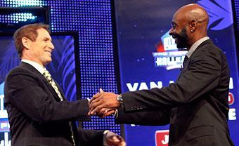 Jerry Rice, right, is congratulated by Steve Young after Rice was announced as a 2010 enshrinee into the Hall of Fame
