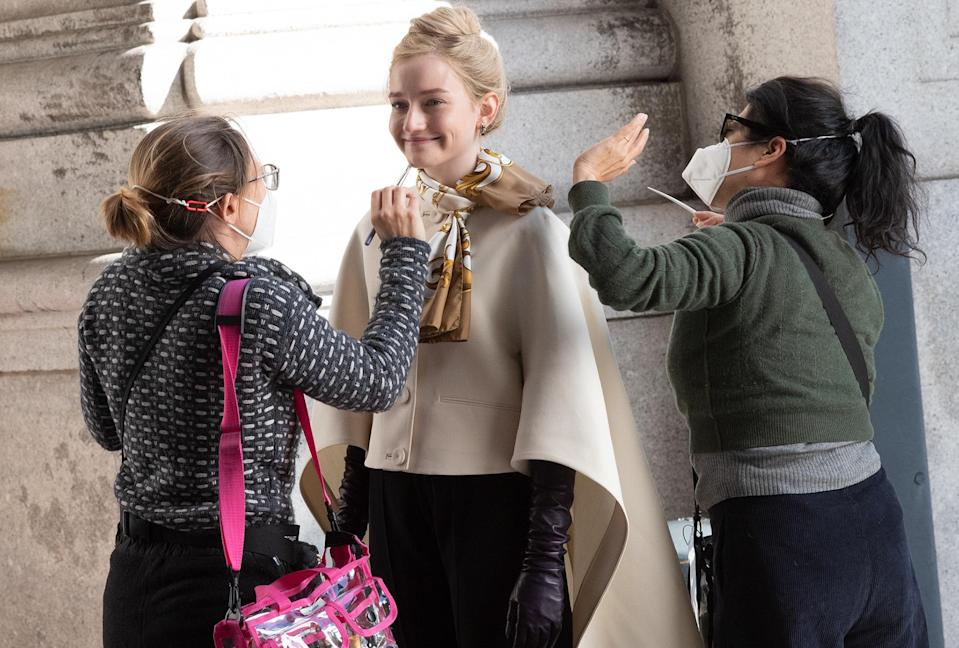 <p>Julia Garner smiles and prepares to film on the set of <em>Inventing Anna</em> in downtown N.Y.C. on Monday. </p>