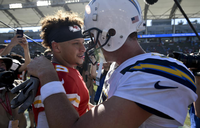Kansas City Chiefs quarterback Patrick Mahomes, left, greets Los Angeles Chargers quarterback Philip Rivers after win during an NFL football game Sunday, Sept. 9, 2018, in Carson, Calif. (AP Photo/Kelvin Kuo)