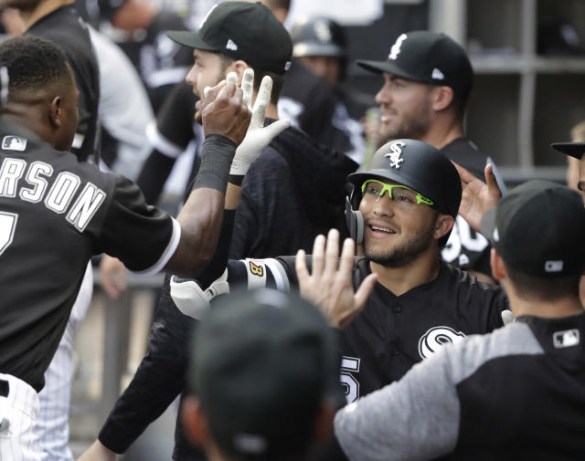 Chicago White Sox's Yolmer Sanchez is congratulated for his home run off Cleveland Indians starting pitcher Adam Plutko during the first inning of a baseball game Tuesday, June 12, 2018, in Chicago. (AP Photo/Charles Rex Arbogast)