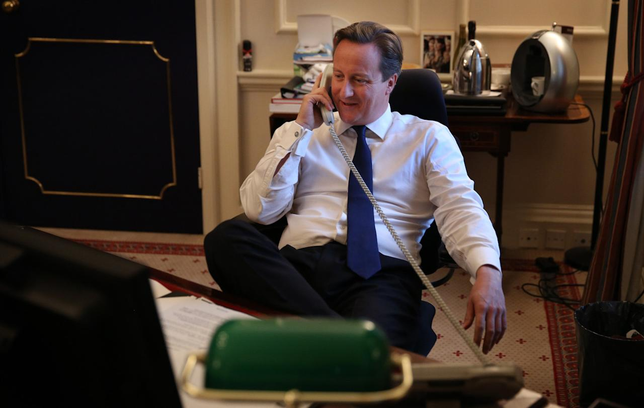 <p>David Cameron faked a photograph of him phoning Barack Obama to congratulate him for becoming the first black US President. </p>