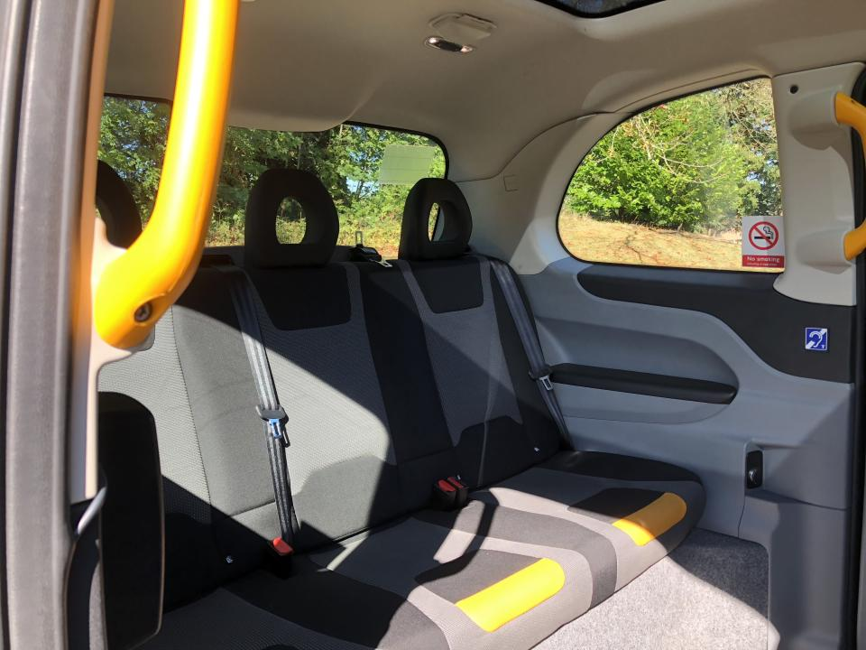 The back of the taxi can accommodate up to six passengers. The front area where the driver sits has space for two large suitcases. Photo: Alanna Petroff
