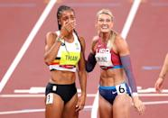 <p>Nafissatou Thiam of Team Belgium reacts after winning the gold medal in the Women's Heptathlon alongside Annie Kunz of Team United States at Olympic Stadium on August 5.</p>