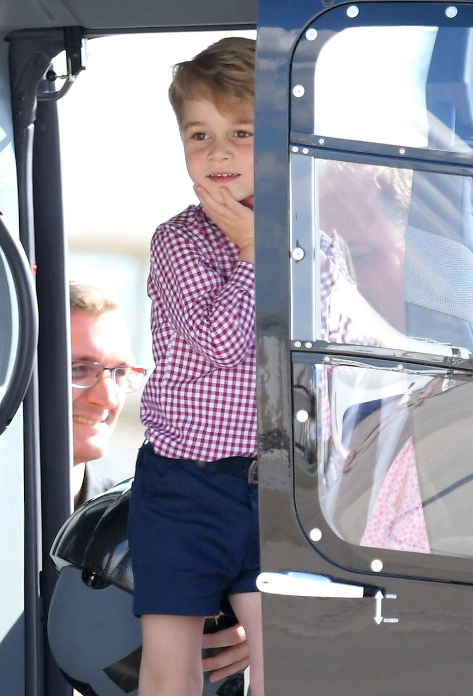 <p>He loved viewing helicopter models H145 and H135 before leaving Hamburg airport on the Cambridges official visit to Poland and Germany in 2017. (Karwai Tang/WireImage)</p>