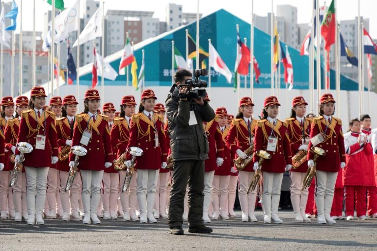 A North Korean cheering band attends a welcoming ceremony for North Korea's athletes at the Olympic Village in Gangneung, on February 8, 2018, ahead of the Pyeongchang 2018 Winter Olympic Games