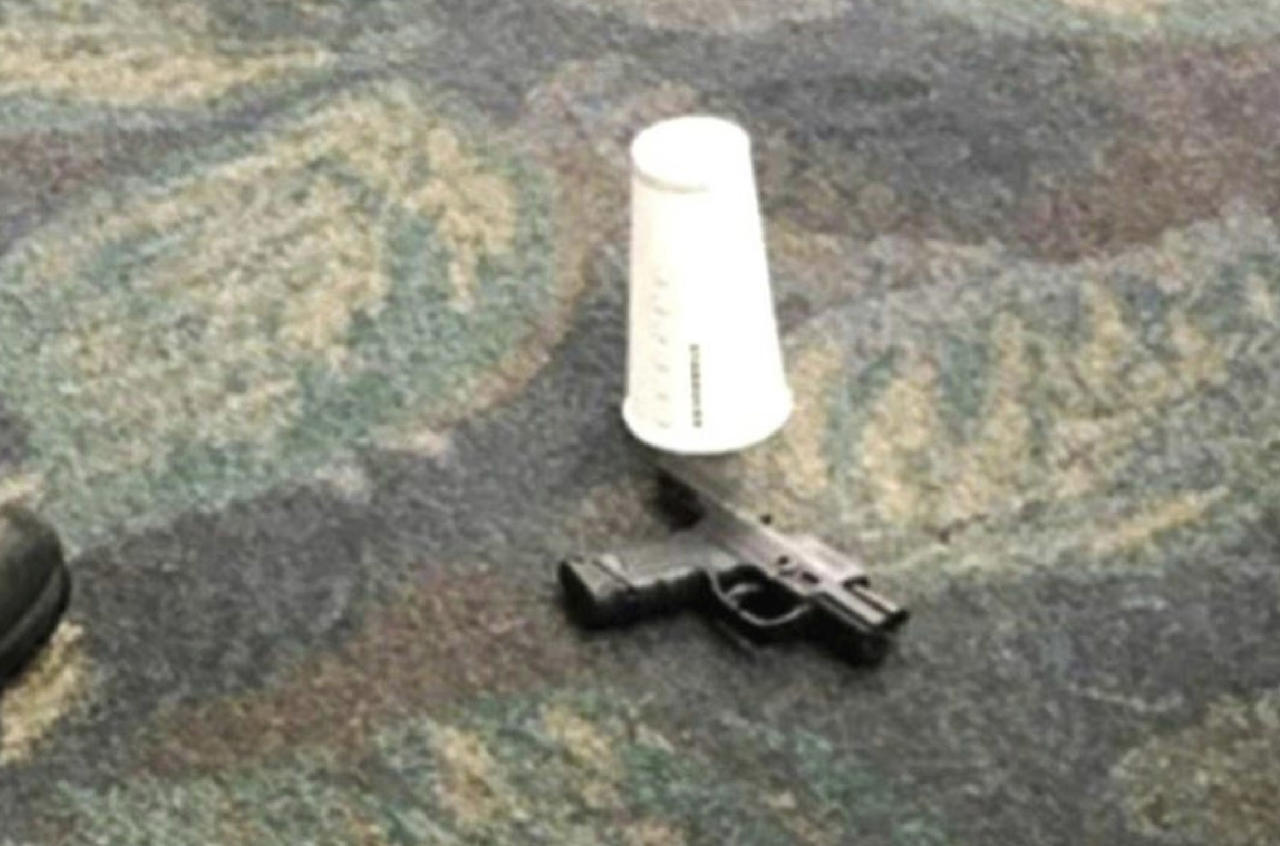 <p>This photo taken Friday, Jan. 6, 2017 by passenger Mark Lea and released by Lea Sunday, Jan. 8 shows a handgun which was used by Iraq war veteran Esteban Santiago when he killed five people is seen on the floor at the scene of the attack at the Fort Lauderdale airport in Florida. (Mark Lea via AP) </p>